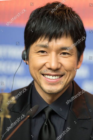 Actor Hidetoshi Nishijima smiles during a press conference for the film 'While the Women Are Sleeping' at the 2016 Berlinale Film Festival in Berlin, Germany