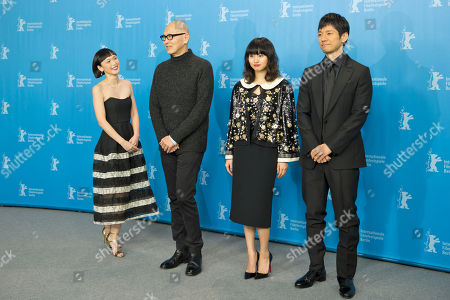 Actress Sayuri Oyamada, director Wayne Wang, actress Shioli Kutsuna and actor Hidetoshi Nishijima, from left, pose for the photographers during a photo call for the film 'While the Women Are Sleeping' at the 2016 Berlinale Film Festival in Berlin, Germany