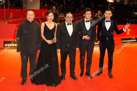 From left, producer Wang Yu, actress Xin Zhi Lei, director Yang Chao, actors Qin Hao, and Wu Lipeng pose, on the red carpet prior to the screening of 'Chang Jiang Tu', at the 2016 Berlinale Film Festival in Berlin