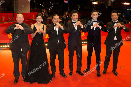 From left, producer Wang Yu, actress Xin Zhi Lei, director Yang Chao, actors Qin Hao, Wu Lipeng and Tan Kai gesture, on the red carpet prior to the screening of 'Chang Jiang Tu', at the 2016 Berlinale Film Festival in Berlin
