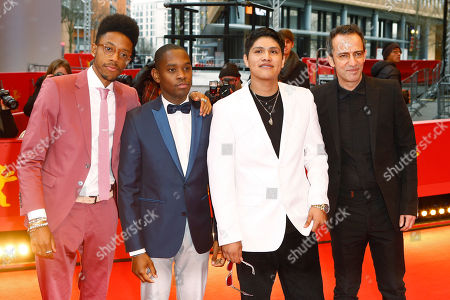 Actors Darrell Britt-Gibson, Aml Ameen, Johnny Ortiz and director Rafi Pitts, from left, pose for the photographers on the red carpet for the film 'Soy Nero' at the 2016 Berlinale Film Festival in Berlin