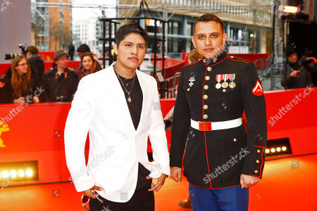Actor Johnny Ortiz, left, and military advisor Daniel Torres, right, pose for the photographers on the red carpet for the film 'Soy Nero' at the 2016 Berlinale Film Festival in Berlin