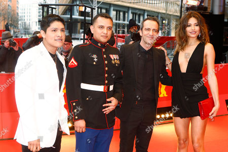 Actor Johnny Ortiz, military advisor Daniel Torres, director Rafi Pitts and actress Pollyanna Uruena, from left, pose for the photographers on the red carpet for the film 'Soy Nero' at the 2016 Berlinale Film Festival in Berlin