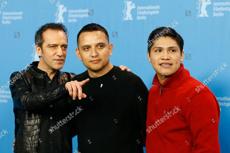 From left, director Rafi Pitts, military advisor Daniel Torres and actor Johnny Ortiz pose for photographer during the photo call for the movie ' Soy Nero', at the 2016 Berlinale Film Festival in Berlin