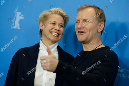 Actors Trine Dyrholm, left and Ulrich Thomsen pose during the photocall for the movie 'The Commune' at the 2016 Berlinale Film Festival in Berlin, Germany