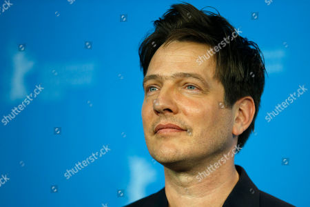 Director Thomas Vinterberg poses during the photocall for the movie 'The Commune' at the 2016 Berlinale Film Festival in Berlin, Germany