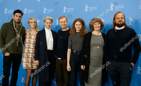 From left, actors Fares Fares, Helene Reingaard Neumann, Trine Dyrholm, Ulrich Thomsen, Martha Sofie Wallstrom, Anne Gry Henningsen and Magnus Millang pose during the photocall for the movie 'The Commune' at the 2016 Berlinale Film Festival in Berlin, Germany