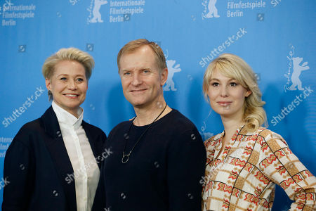 From left, actors Trine Dyrholm, Ulrich Thomsen and Helene Reingaard Neumann pose during the photocall for the movie ' The Commune' at the 2016 Berlinale Film Festival in Berlin, Germany
