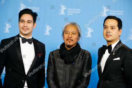 Actor Piolo Pascual, left, director Lav Diaz, center, and actor John Lloyd Cruz, right, pose for photographers during a photo call for the competition film 'A Lullaby To The Sorrowful Mystery' at the 2016 Berlinale Film Festival in Berlin, Germany