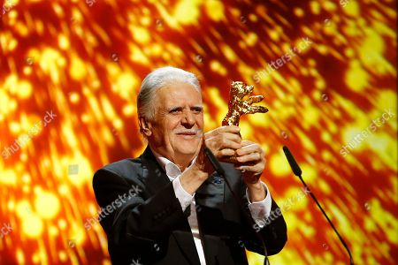 German cinematographer Michael Ballhaus shows the Honorary Golden Bear after being awarded for his lifetime achievement during the awarding ceremony at the 2016 Berlinale Film Festival in Berlin, Germany