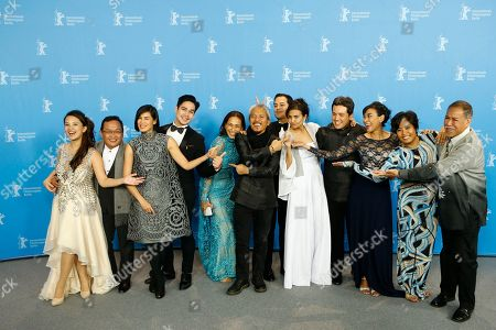From left: Producer Bianca Balbuena, actor Joel Saracho, actress Angel Aquino, actor Piolo Pascual, actress Cherie Gil, director Lav Diaz, actor John Lloyd Cruz, actress Alessandra De Rossi, producer Paul Soriano, actress Susan Africa, actress, Hazel Orencio and actor Bernardo Bernardo pose for photographers during a photo call for the competition film 'A Lullaby To The Sorrowful Mystery' at the 2016 Berlinale Film Festival in Berlin, Germany