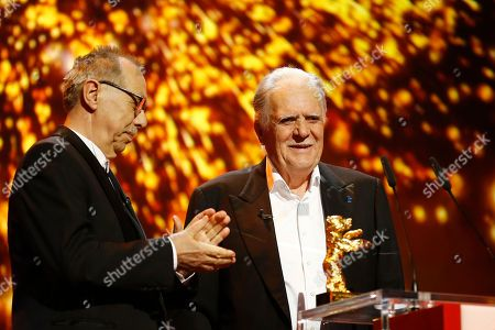 German cinematographer Michael Ballhaus, right, receives the Honorary Golden Bear for his lifetime achievement from festival director Dieter Kosslick, left, during the award ceremony at the 2016 Berlinale Film Festival in Berlin, Germany