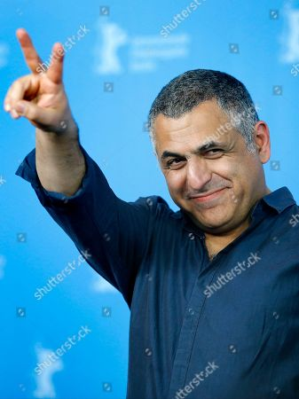 Director Mani Haghighi poses for the photographers during a photo call for the film 'A Dragon Arrives!' at the 2016 Berlinale Film Festival in Berlin, Germany