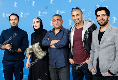 Actor Homayoun Ghanizadeh, actress Kiana Tajammol, director Mani Haghighi, actor Amir Jadidi and actor Ehsan Goudarzi, from left, pose for the photographers during a photo call for the film 'A Dragon Arrives!' at the 2016 Berlinale Film Festival in Berlin, Germany