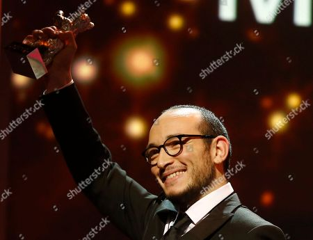 Majd Mastoura displays his Silver Bear he received as best actor for his role in 'Inhebek Hedi', during the award ceremony at the 2016 Berlinale Film Festival in Berlin