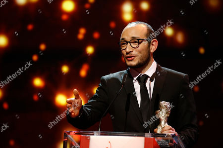 Stock Image of Majd Mastoura addresses the audience after receiving the Silver Bear for best actor for his role in 'Inhebek Hedi', during the award ceremony at the 2016 Berlinale Film Festival in Berlin