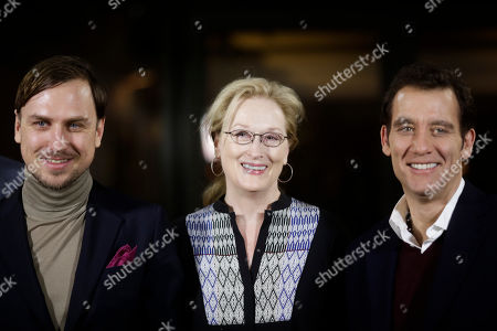 The president of the International Jury of the 2016 Berlinale Film Festival Meryl Streep, center, poses with jury members Lars Eidinger, left, and Clive Owen for a photo on the eve of the film festival in Berlin