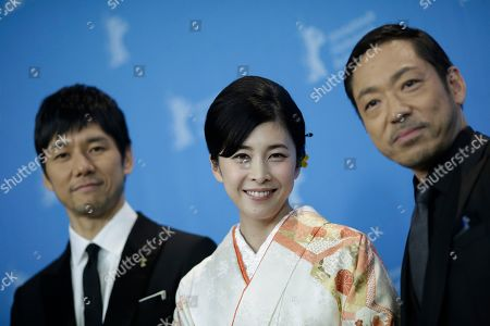 Actors Hidetoshi Nishijima, Yuko Takeuchi and Teruyuki Kagawa, from left, poses for photographers during a photo call for the film 'Creepy' at the 2016 Berlinale Film Festival in Berlin, Germany