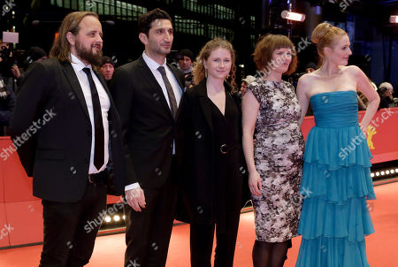 Stock Picture of Actors Magnus Millang, Fares Fares, Martha Sofie Wallstrom, Anne Gry Henningsen and Julie Agnete Vang, from left, pose for the photographers on the red carpet for the film 'The Commune' at the 2016 Berlinale Film Festival in Berlin, Germany