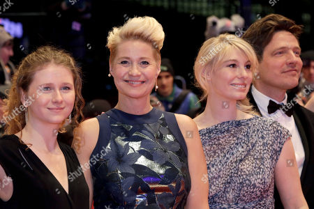 Actresses Martha Sofie Wallstrom, Trine Dyrholm, Helene Reingaard Neumann and director Thomas Vinterberg, from left, pose for the photographers on the red carpet for the film 'The Commune' at the 2016 Berlinale Film Festival in Berlin, Germany
