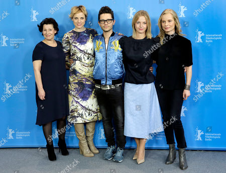 Director Tomasz Wasilewski, center, and the actresses, from left, Dorota Kolak, Julia Kijowska, Marta Nieradkiewicz and Magdalena Cielecka pose for the photographers during a photo call for the film 'United States of Love' at the 2016 Berlinale Film Festival in Berlin, Germany