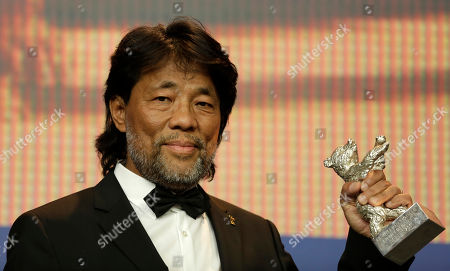 Mark Lee Ping-Bing, cameraman of 'Chang Jiang Tu' holds his Silver Bear for Outstanding Artistic Contribution during a press conference after the award ceremony of the 2016 Berlinale Film Festival in Berlin, Germany