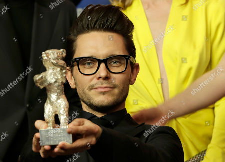 Director Tomasz Wasilewski holds his Silver Bear during the press conference after the award ceremony of the 2016 Berlinale Film Festival in Berlin, Germany
