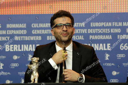 Danis Tanovic, the director of 'Smrt u Sarajevu' shows off a Silver Bear he was awarded as Grand Jury Prize during a press conference after the award ceremony of the 2016 Berlinale Film Festival in Berlin, Germany