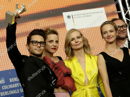 Director Tomasz Wasilewski and actresses Julia Kijowska, Magdalena Cielecka and Marta Nieradkiewicz, from left, pose for a photograph during the press conference after the award ceremony of the 2016 Berlinale Film Festival in Berlin, Germany