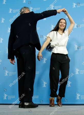 Festival Director Dieter Kosslick, left, and director Anne Zohra Berrached, right, dance as they arrive for a photo call for the film '24 Weeks' at the 2016 Berlinale Film Festival in Berlin, Germany