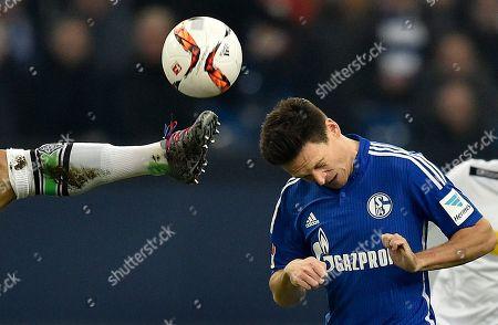 Schalke's Sascha Riether jumps for the ball during the German Bundesliga soccer match between FC Schalke 04 and Borussia Moenchengladbach in Gelsenkirchen, Germany