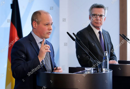 Morgan Johansson, left, Migration Minister of Sweden, and German Interior Minister Thomas de Maiziere, right, address the media during a joint news conference as part of a meeting at the Interior Ministry in Berlin, Germany