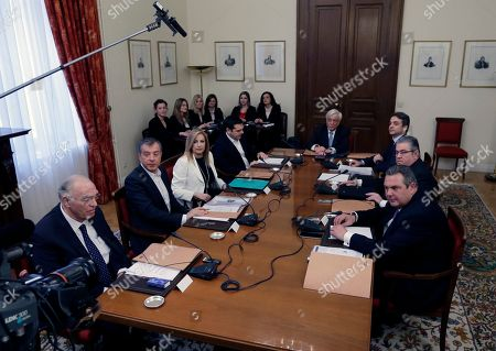 Prokopis Pavlopoulos, Vassilis Levedis, Stavros Theodorakis, Fofi Gennimata, Alexis Tsipras, Kyriakos Mitsotakis, Dimitris Koutsoumbas, Panos Kammenos Greek President Prokopis Pavlopoulos, center, leads a meeting of the Greek political party leaders, from left to right, Vassilis Levedis of the Centrists' Union, leader of Potami party (The River) Stavros Theodorakis, PASOK Socialist party leader Fofi Gennimata, Greek Prime Minister and head of the left-wing Syriza party Alexis Tsipras, leader of the New Democracy Kyriakos Mitsotakis, Greek Communist Party leader Dimitris Koutsoumbas, and Greek Defense Minister Panos Kammenos, who heads the government's junior coalition member Independent Greeks at the Presidential palace in Athens, . Greek politicians held the meeting to discuss the migration crisis as officials said Thursday that nearly 32,000 migrants were stranded in the country following a decision by Austria and four ex-Yugolsav countries to drastically reduce the number of transiting migrants