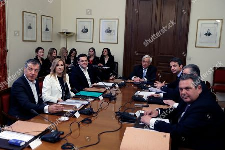 Prokopis Pavlopoulos, Stavros Theodorakis, Fofi Gennimata, Alexis Tsipras, Kyriakos Mitsotakis, Dimitris Koutsoumbas, Panos Kammenos Greek President Prokopis Pavlopoulos, center, leads a meeting of the Greek political party leaders, from left, leader of Potami party (The River) Stavros Theodorakis, PASOK Socialist party leader Fofi Gennimata, Greek Prime Minister and head of the left-wing Syriza party Alexis Tsipras, leader of the New Democracy Kyriakos Mitsotakis, Greek Communist Party leader Dimitris Koutsoumbas, and Greek Defense Minister Panos Kammenos, who heads the government's junior coalition member Independent Greeks at the Presidential palace in Athens, . Greek politicians hold the meeting to discuss the migration crisis as officials said Thursday that nearly 32,000 migrants were stranded in the country following a decision by Austria and four ex-Yugolsav countries to drastically reduce the number of transiting migrants