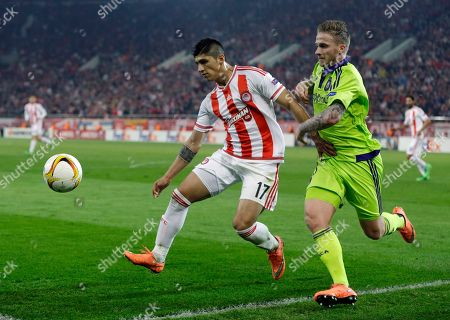 Alan Pulido, Alexander Buttner Olympiakos' Alan Pulido, left, fights for the ball with Anderlecht's Alexander Buttner during the Europa League round of 32 soccer match between Olympiakos and Anderlecht at the Georgios Karaiskakis stadium in the port of Piraeus, near Athens