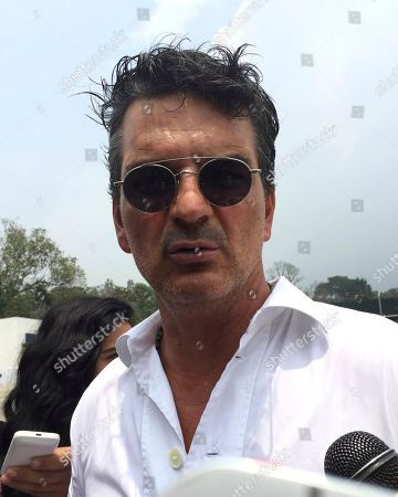 Ricardo Arjona Guatemalan singer Ricardo Arjona speaks to reporters during the inauguration of a school in the municipality of Alotenango, in Guatemala's southern state of Sacatepequez, . Arjona inaugurated his second school for children on Wednesday