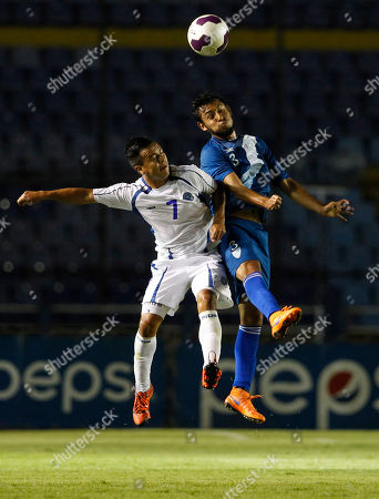 El Salvador Jorge Moran, left, and Guatemala's Cristian Jimenez jump for the ball during a friendly soccer match in Guatemala City