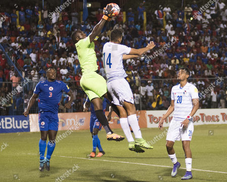 Haiti's goalkeeper Johny Placide saves a head shot by Panama's Valentin Pimentel during a 2018 World Cup qualifying soccer match in Port-au-Prince, Haiti