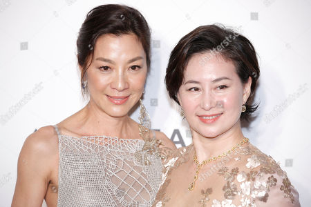 Michelle Yeoh, Pansy Ho Malaysia actress Michelle Yeoh, left, and Managing Director of Shun Tak Holdings Pansy Ho pose on the red carpet for the fundraising gala organized by amfAR (The Foundation for AIDS Research) in Hong Kong