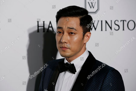 So Ji-sub South Korea actor So Ji-sub poses on the red carpet during the fundraising gala organized by amfAR (The Foundation for AIDS Research) in Hong Kong