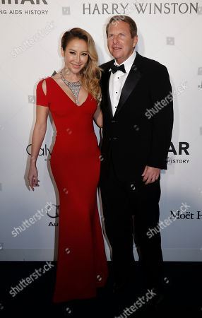 Coco Lee, Bruce Rockowitz Taiwanese-American singer Coco Lee, left, and her husband Bruce Rockowitz pose on the red carpet during the fundraising gala organized by amfAR (The Foundation for AIDS Research) in Hong Kong