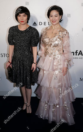 Pansy Ho, Josie Ho Managing Director of Shun Tak Holdings Pansy Ho, right, and her sister actress-singer Josie Ho pose on the red carpet during the fundraising gala organized by amfAR (The Foundation for AIDS Research) in Hong Kong