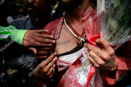 A fan shows a tattoo named after Bollywood actor Sanjay Dutt on his chest in Mumbai, India, . Bollywood actor Sanjay Dutt walked free Thursday after completing his five-year prison sentence for illegal weapons possession in a case linked to the 1993 terror attack in India's financial capital Mumbai