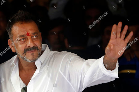 Sanjay Dutt Bollywood actor Sanjay Dutt waves at his supporters after arriving at his residence in Mumbai, India, . Actor Dutt walked free Thursday after completing his five-year prison sentence for illegal weapons possession in a case linked to the 1993 terror attack in India's financial capital Mumbai