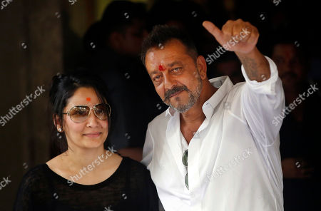 Sanjay Dutt, Manyata Bollywood actor Sanjay Dutt, right, shows a thumbs up sign along with his wife Maanyata after arriving at his residence in Mumbai, India, . Actor Dutt walked free Thursday after completing his five-year prison sentence for illegal weapons possession in a case linked to the 1993 terror attack in India's financial capital Mumbai