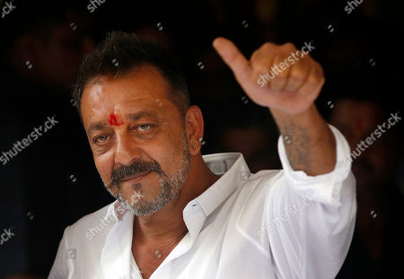 Sanjay Dutt Bollywood actor Sanjay Dutt shows a thumbs up sign after arriving at his residence in Mumbai, India, . Actor Dutt walked free Thursday after completing his five-year prison sentence for illegal weapons possession in a case linked to the 1993 terror attack in India's financial capital Mumbai