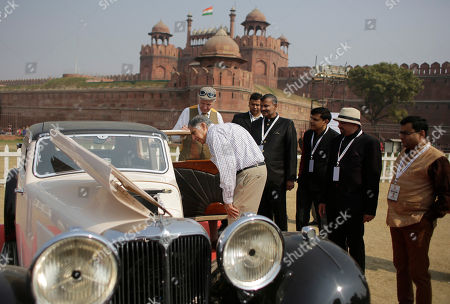 Ratan Tata Indian industrialist Ratan Tata leans to have a closer look at the interior of a 1933 Jaguar SS one Coupe displayed at the 6th 21 Gun Salute International Vintage Car Rally & Concours Show in New Delhi, India, . Seen behind is the Red Fort monument