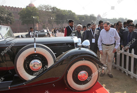 Ratan Tata Indian industrialist Ratan Tata right, in white check shirt, looks a vintage car displayed at the 6th 21 Gun Salute International Vintage Car Rally & Concours Show in New Delhi, India
