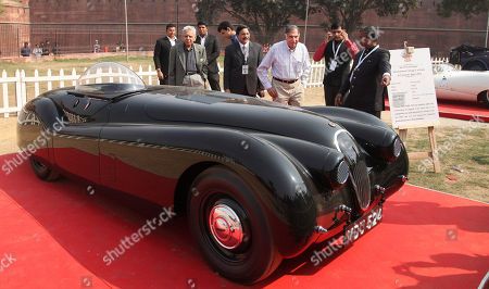 Ratan Tata Indian industrialist Ratan Tata, in white check shirt, looks at a 1952 Jaguar XK 120 at the 6th 21 Gun Salute International Vintage Car Rally & Concours Show in New Delhi, India