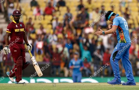 Hamid Hassan, Johnson Charles Afghanistan's Hamid Hassan, right, reacts after taking the wicket of West Indies' Johnson Charles, left, during their ICC World Twenty20 2016 cricket match in Nagpur, India